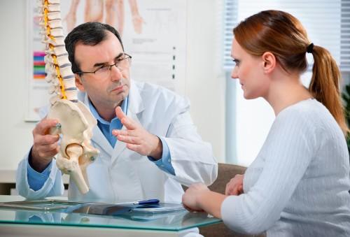 Причины, симптомы и лечение боли в пояснице